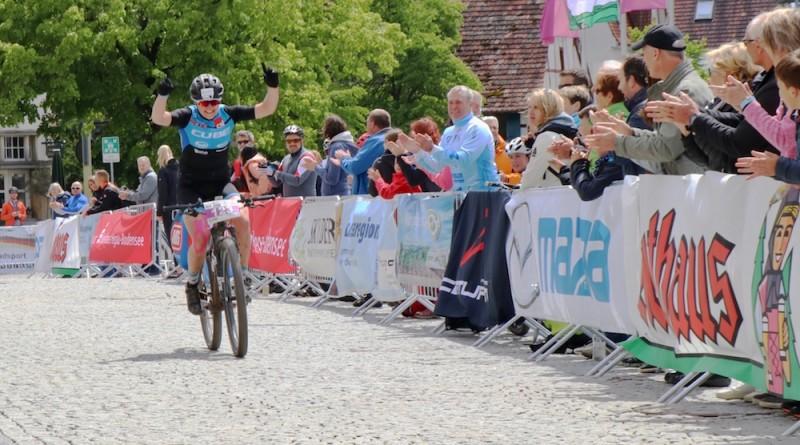 Janine-Schneider_finish_winning_HBM19-Hegau-Bike-Marathon-by-Goller.jpg